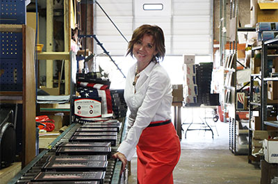 Kerry McCoy in the warehouse of FlagandBanner.com